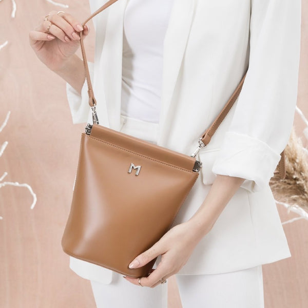vegan, cruelty free, handbag, bag, purse, faux leather, animal friendly, sustainable fashion, crossbody, small, silver hardware, tan, saddle, brown, cognac