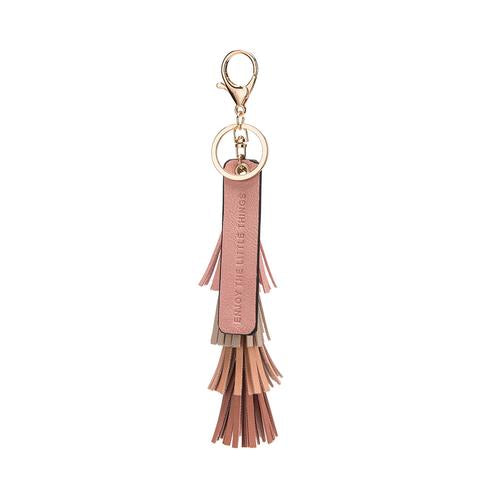 vegan, cruelty free, handbag, bag, purse, faux leather, animal friendly, sustainable fashion, keychain, tassel, gold hardware, quote, enjoy the little things, pink