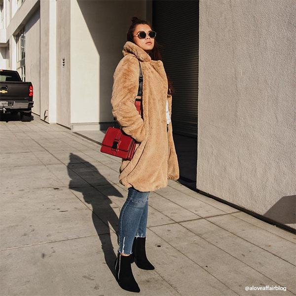 Instagram Influencer wearing Melie Bianco Luxury Vegan Leather Stalking Gia Wine Crossbody Belt Bag Purse
