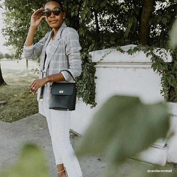 Instagram Influencer wearing Melie Bianco Luxury Vegan Leather Remy Black Top Handle Crossbody Bag Purse