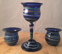 Beautiful hand made glass goblets, available in a variety of colors and designs.
