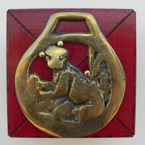 Horse Brass on Red Lacquered Frame