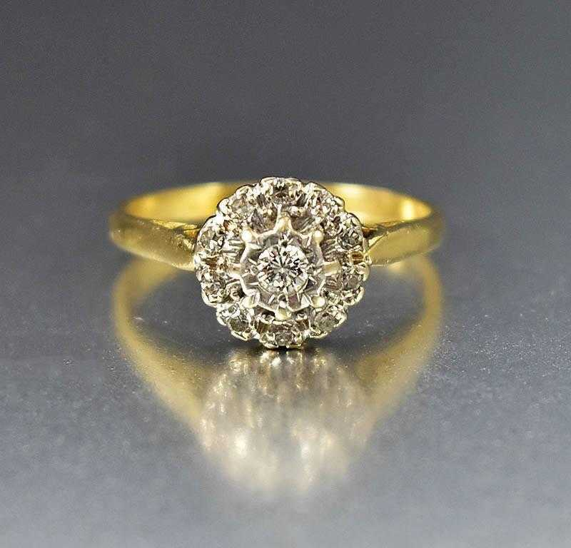 antique cluster engagement ring on hold