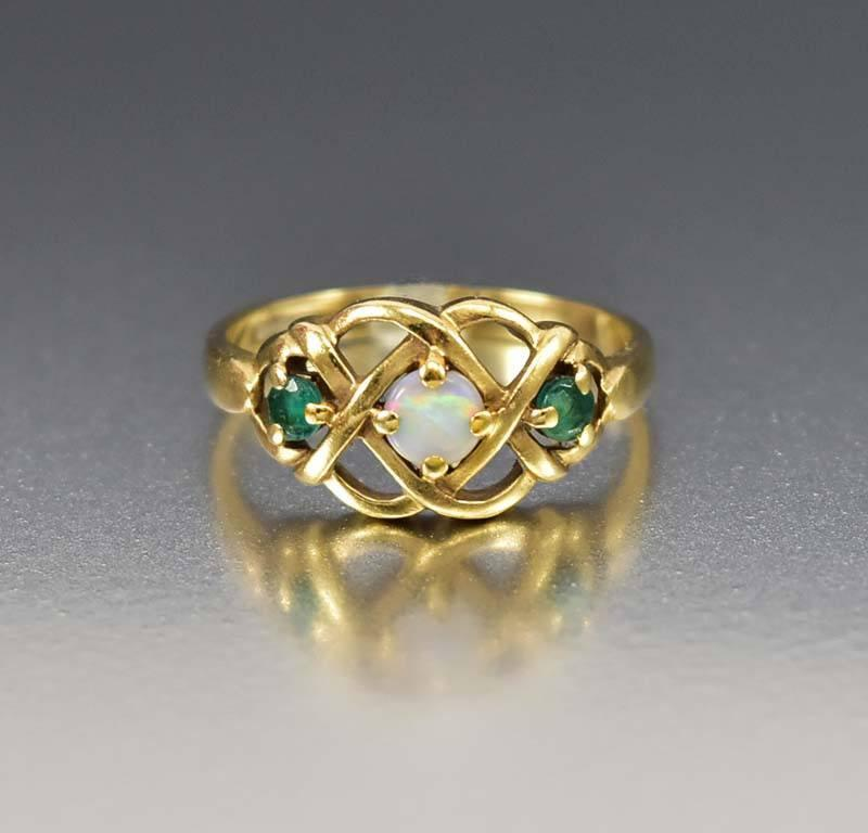 gold celtic knot opal emerald engagement ring