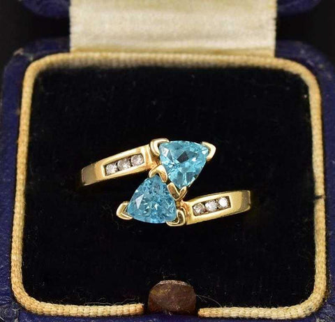 Quality Gold Diamond and Blue Topaz ByPass Ring