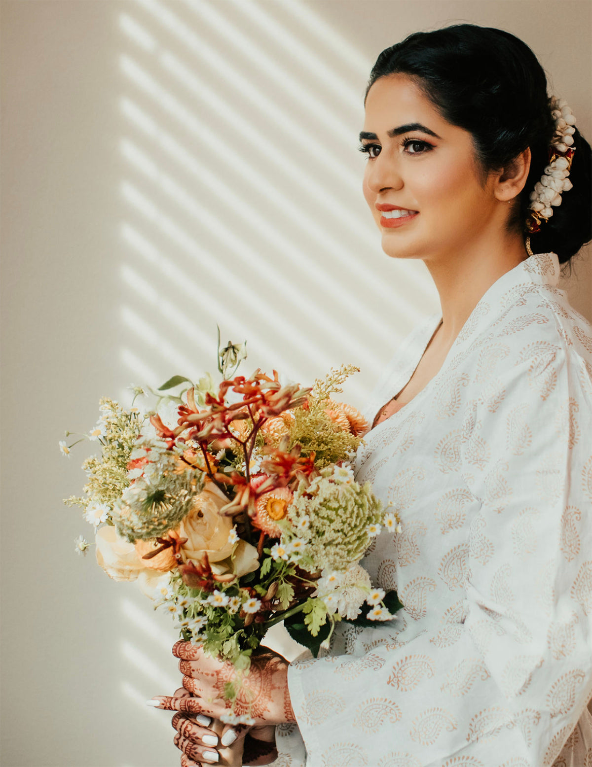 Indian bride in robe with bouquet