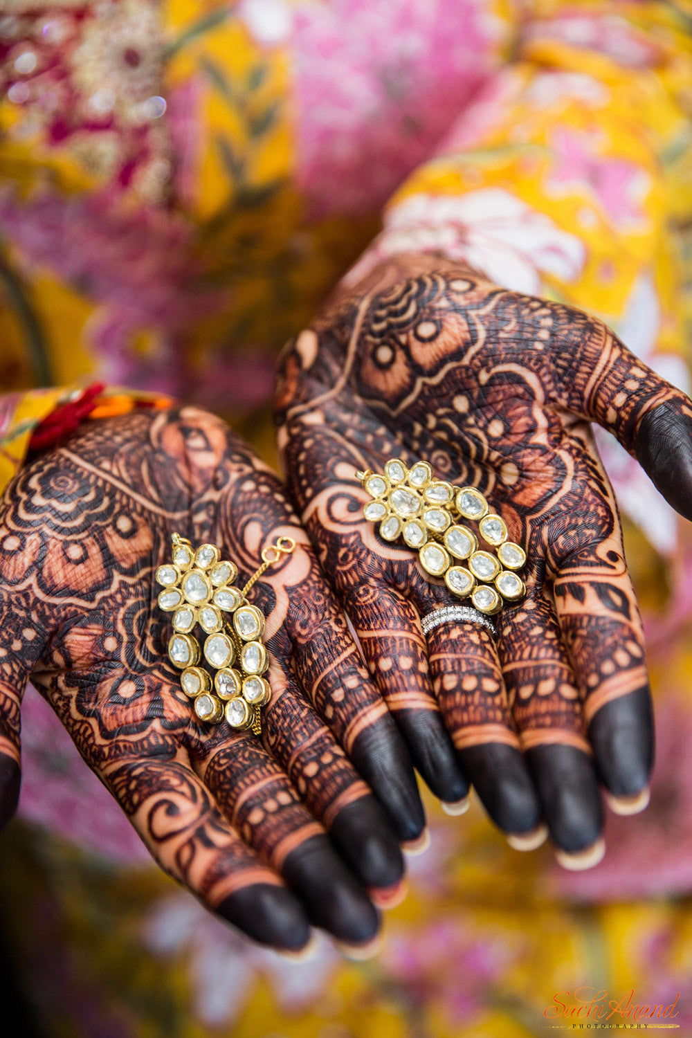 bride mehndi hands with jewelry