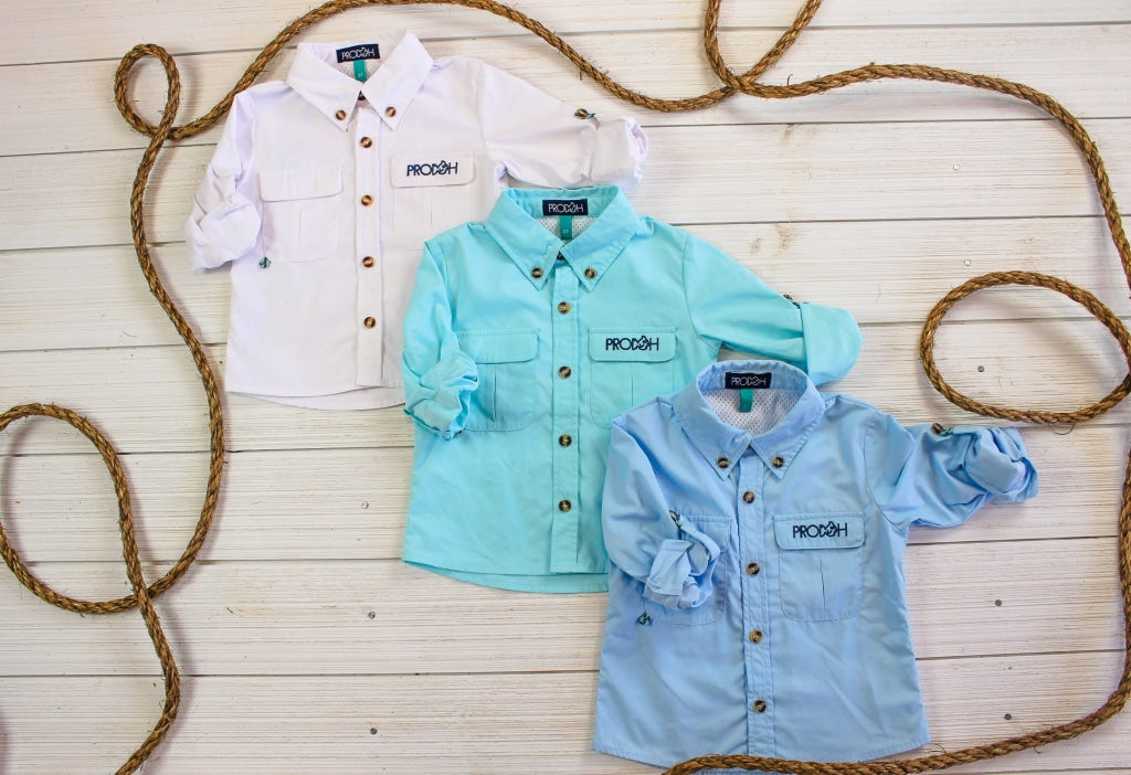 solid light blue fishing shirt with chest pockets. UPF 50+ Polyester/Cotton/Spandex Blend Wrinkle and Stain Resistant Quick Dry Vented Back that keeps kids cool and dry