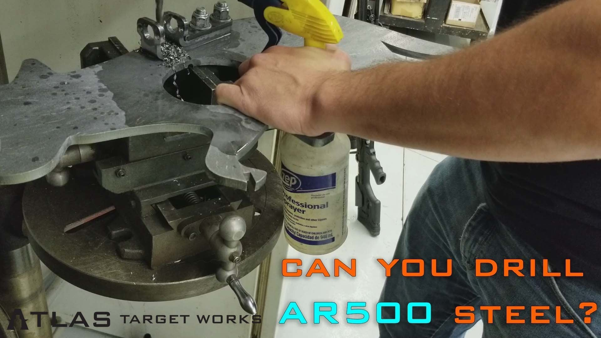 AR500 steel target having an additional hole drilled in it