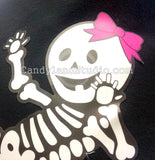 Add a hair bow to your baby skeleton
