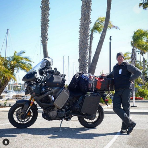 Cannonball Run rider Adam Frasca in Redondo Beach, California at the end of his world record ride.