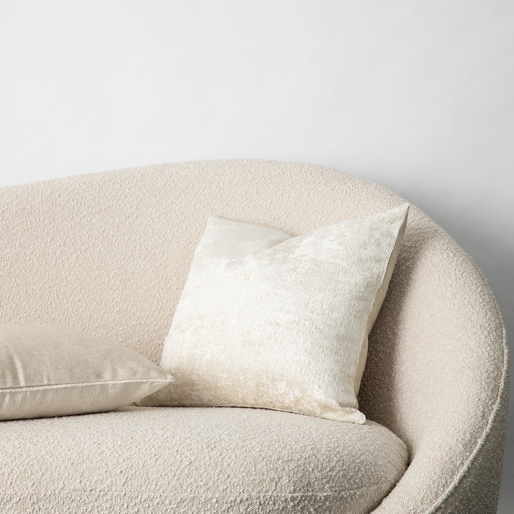 The Talik Velvet Cushion in Cream on a boucle lounge.
