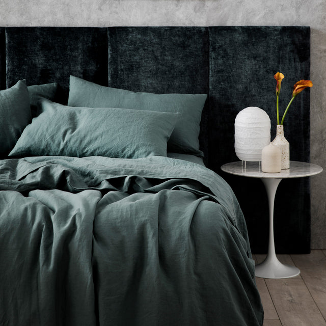 Bed styled with Bluestone Duvet Cover set and Bluestone Sheet set.