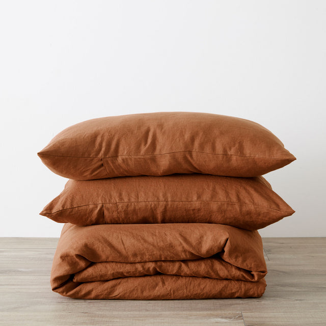 Linen Duvet Cover Set in Cedar folded and stacked.