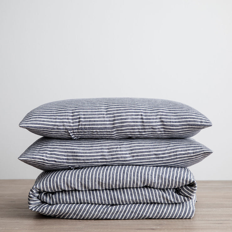 Linen Duvet Cover Set in Indigo Stripe folded and stacked.