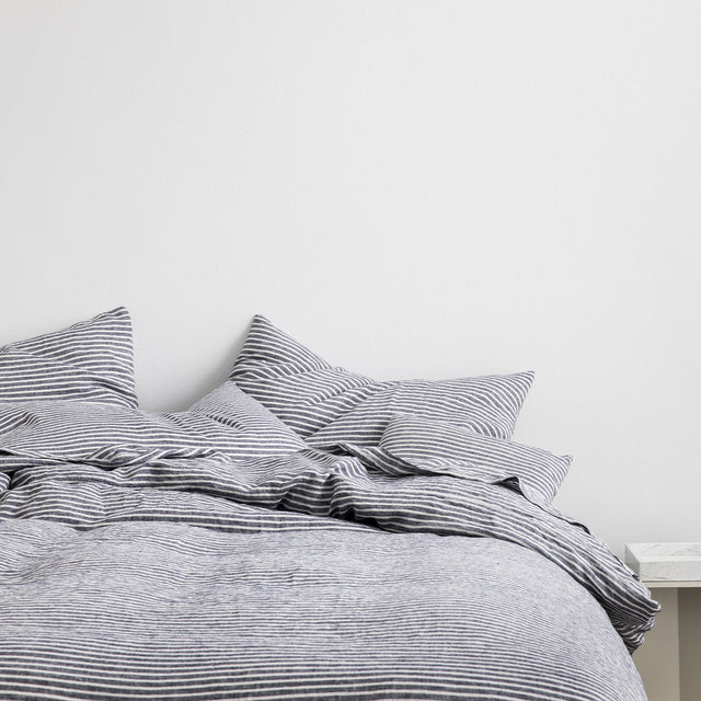 Bed styled in Linen Duvet Cover Set and Linen Sheet Set inIndigo Stripe.