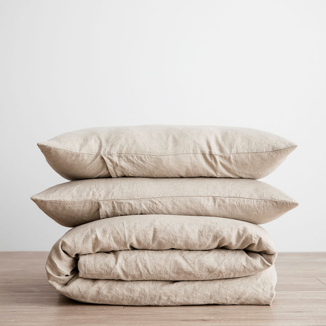 Linen Duvet Cover Set in Natural folded and stacked.