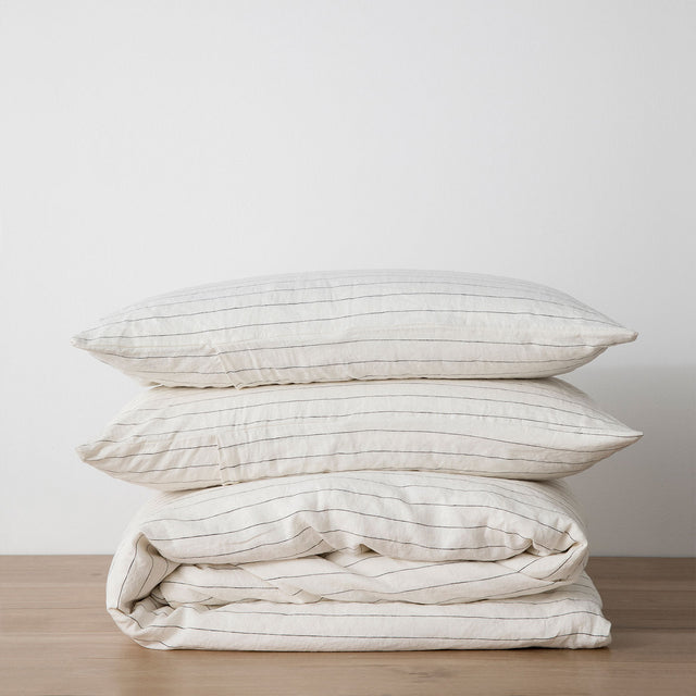 Linen Duvet Cover Set in Pencil Stripe folded and stacked.