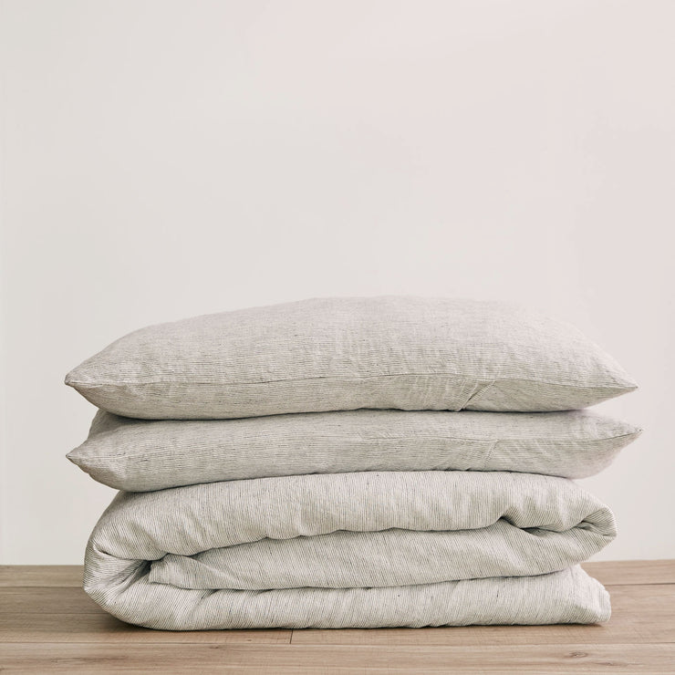 Linen Duvet Cover Set in Pinstripe, folded and stacked.
