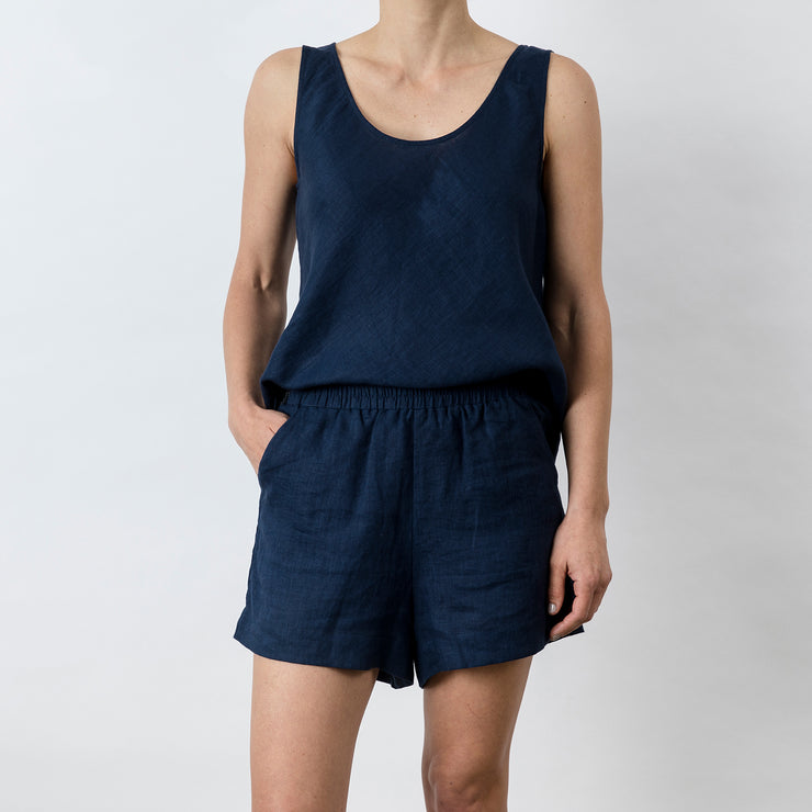 Front view of Piper Linen Short in Midnight. Model is also wearing the matching Piper Linen Singlet in Midnight.