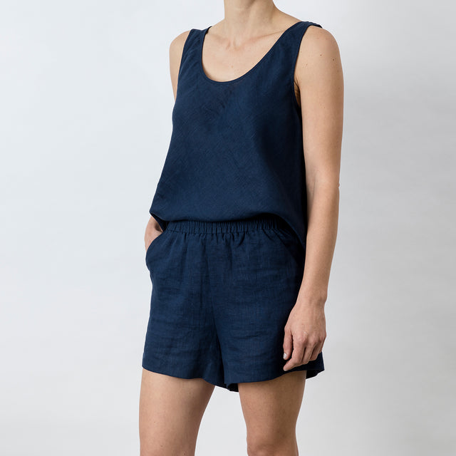 Side view of Piper Linen Short in Midnight. Model is also wearing the matching Piper Linen Singlet in Midnight.