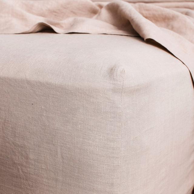 Close up image of Linen Fitted Sheet in Blush.
