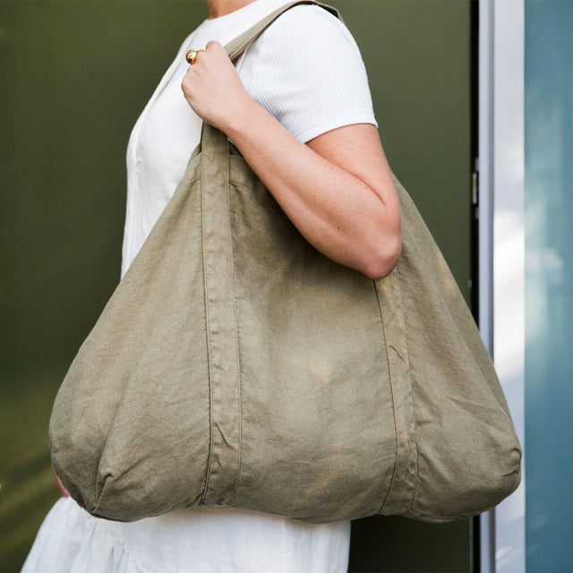 Model wearing Frankie Linen Bag in Olive color