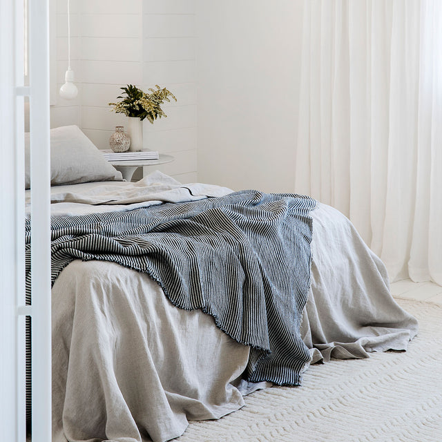 Bed with Natural Linen Bedding and Mira Linen Throw in Ellis Stripe