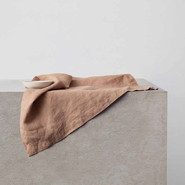 Linen Table Napkin in Fawn, a dusty brown and pink color.