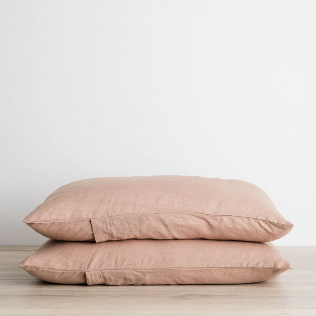 Stack of 2 Linen Pillowcases in Fawn, a dusty brown and pink color.