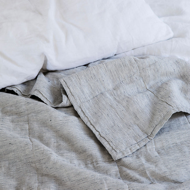 Linen Quilted Bedcover in Pinstripe with a White Linen Pillowcase