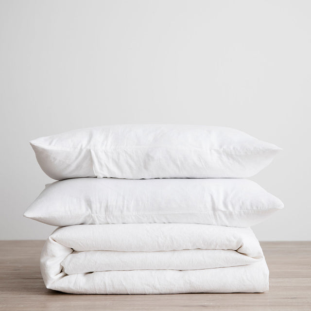 Linen Duvet Cover Set in White, folded and stacked.