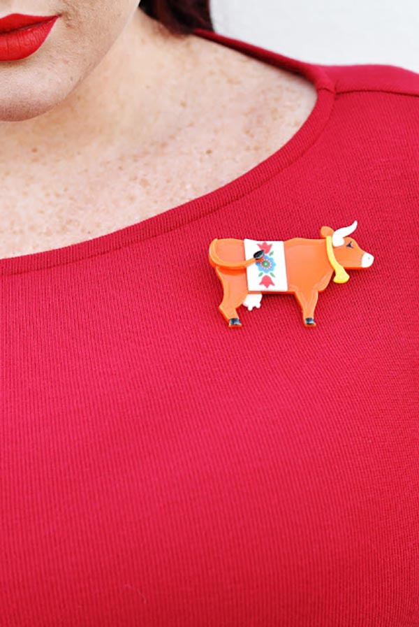 Teer Wayde wearing Erstwilder Daisy the Kissing Cow Brooch