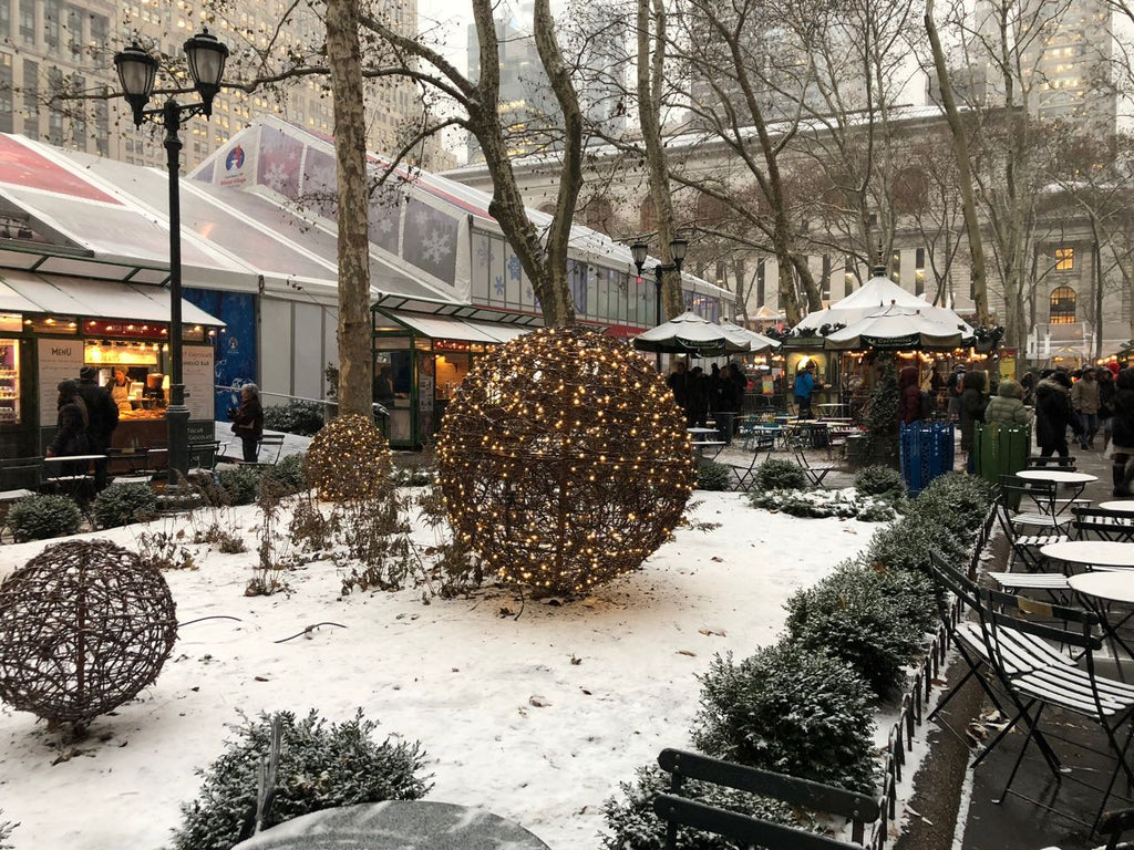 Hot mulled wine and other Christmastime treats are sold from the stalls at Bryant Park