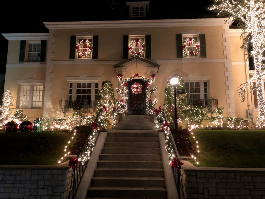 Classic Dyker Height Christmas lights on a traditional home