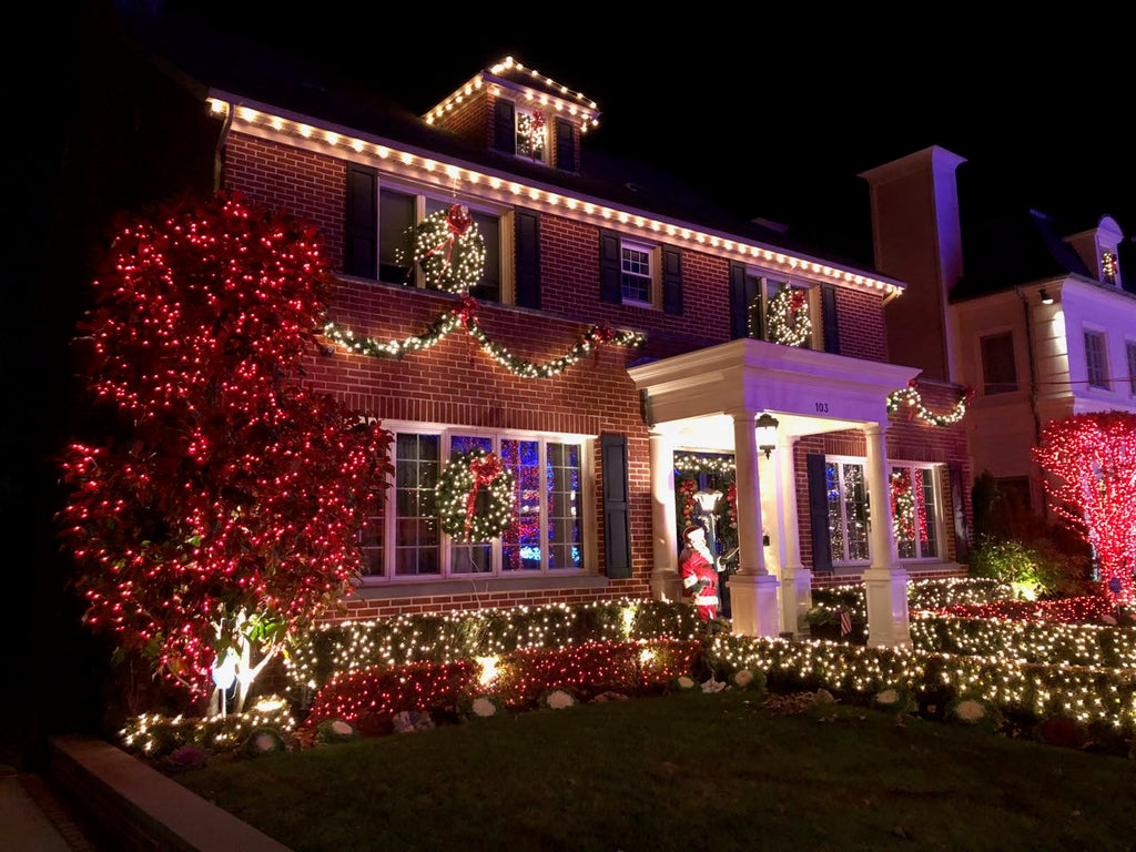 Santa greets visitors at this jolly home