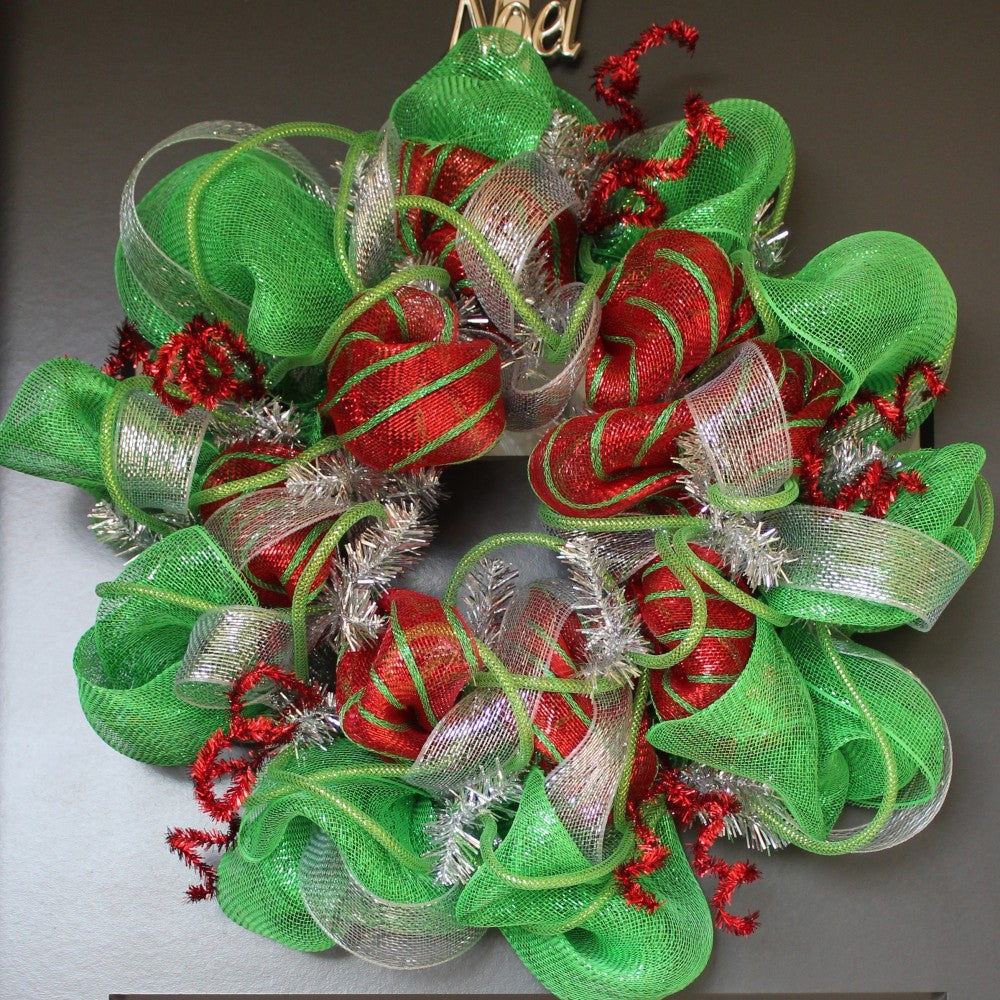 Deco mesh and twisted red glitter sticks Christmas Wreath
