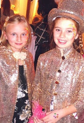 2 girl's wearing sequin cape and gold ringmaster's jacket