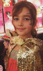 Girl wearing gold sequin cape