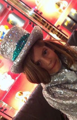 Girl wearing silver sequin hat