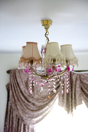 Gold sequin curtain with lamp