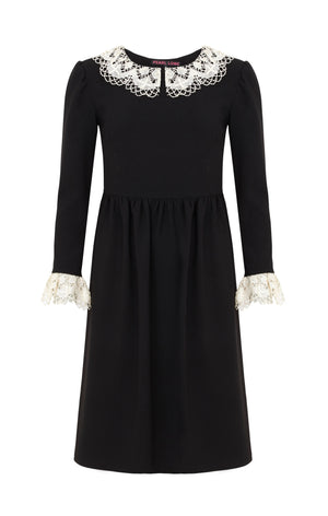 A black crepe Knee length dress, with antique lace collar and cuffs.  Handmade in Somerset, UK by local seamstresses, Pearl Lowe's vintage inspired dresses accentuate the feminine figure.
