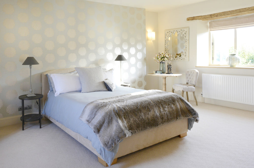 A bedroom interior with pale colours
