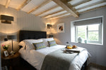 A traditional bedroom interior with wooden walls and roof by Cotswold Grey
