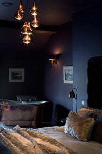 A copper bath in Siskin a Luxury apartment at Cotswold Grey.