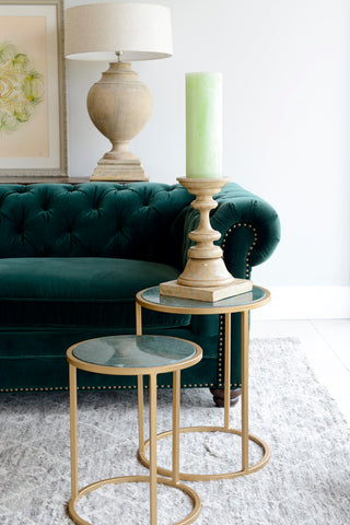 A subtle green interior with candle and velvet sofa by Cotswold Grey