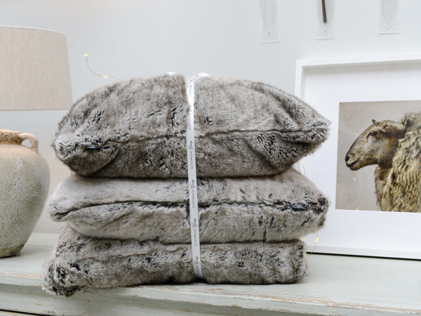 A bundled Cotswold Grey Faux Fur cushions and throw.