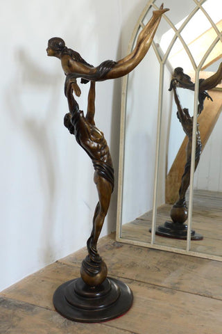 Bronze statue of two figures dancing: The Lift