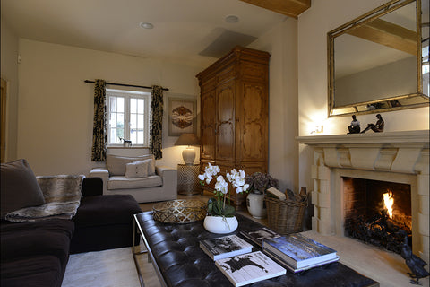 A traditional living room with lights, window and fireplace by Cotswold Grey