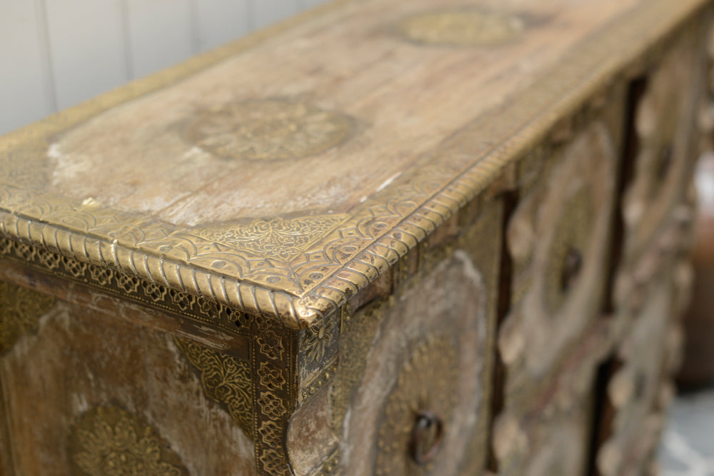 A shot of the corner of the cabinet, showing the detail which runs along the edge